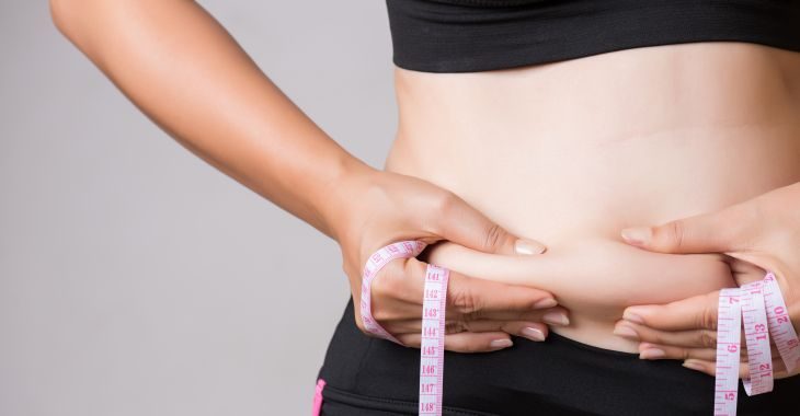 Woman With Excessive Fat At Her Waistline Considering CoolSculpting Procedure