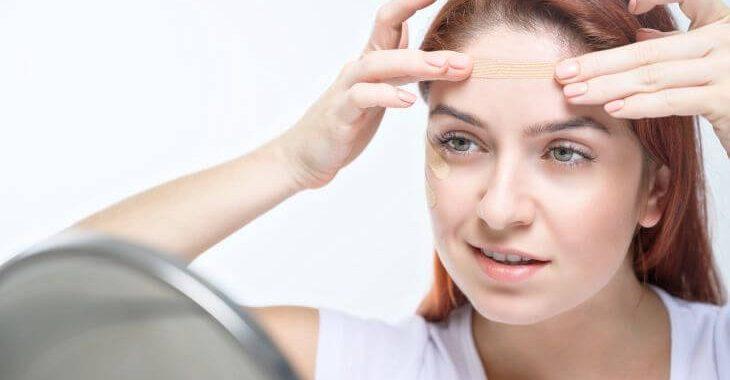 Woman applying frownies