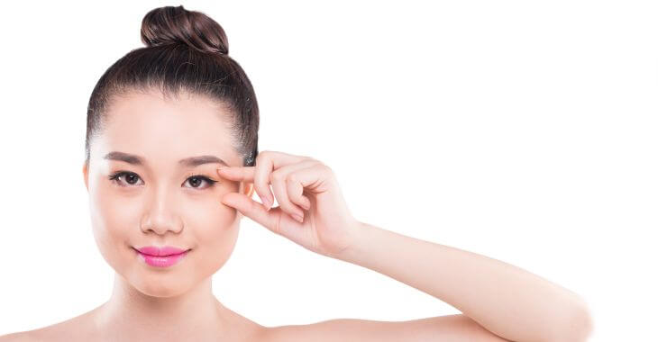 Young Asian woman considering double eyelid surgery