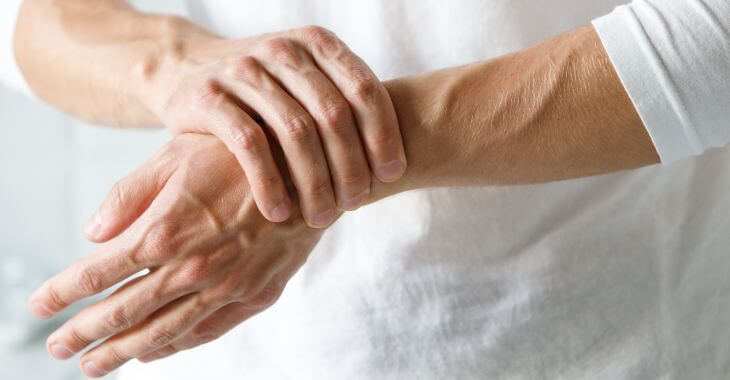 Hands of a person suffering from arthritis pain.