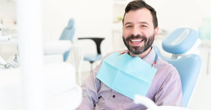 Relaxed happy man in a dental chair after having root canal completed