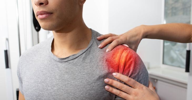A doctor checking how is the patient's shoulder healing after surgery.