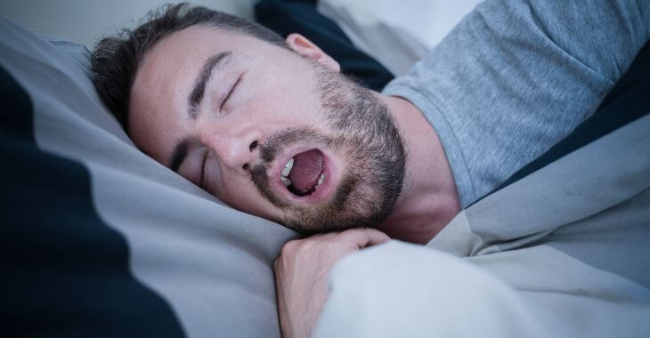 Man sleeping with his mouth open.