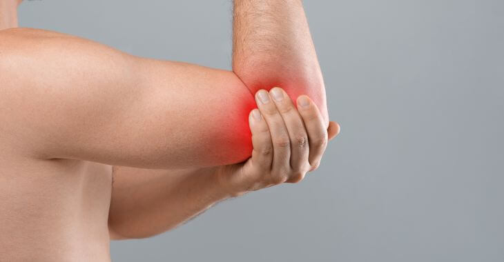 Man suffering from elbow tendonitis.