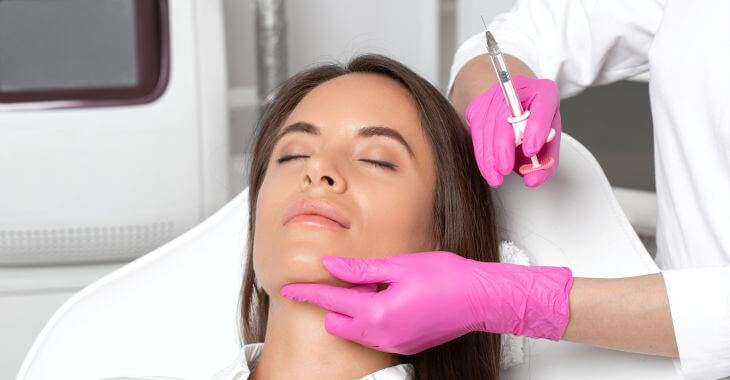 A woman receiving injections for noce and bunny lines correction.
