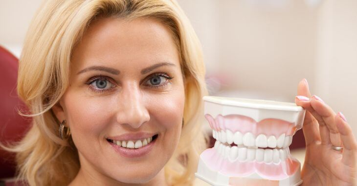 Woman with a dental model