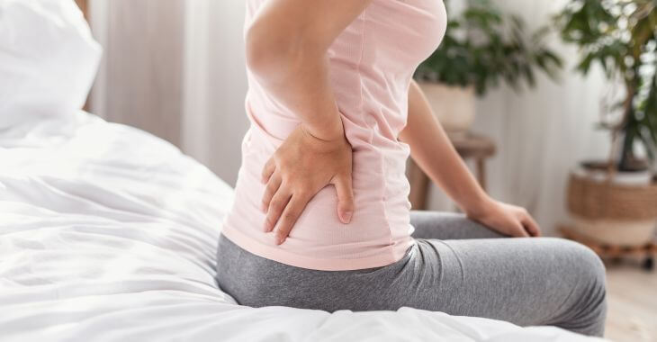 A woman with back stifness and pain due to disc desiccation.